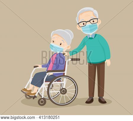 Elderly Woman Wearing Medical Mask Sit In A Wheelchair And The Old Man Stand Near. Couple Of Elderly