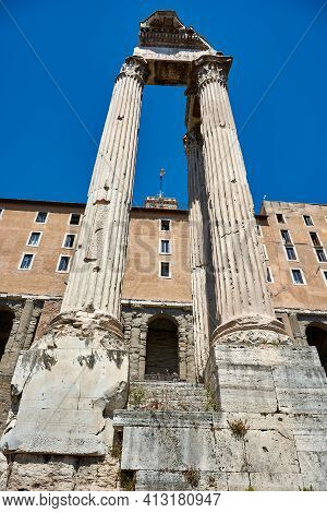 Roman Forum, Rome, Italy - May 17, 2017: View From Below Of The Temple Of Vespasian And Titus At The