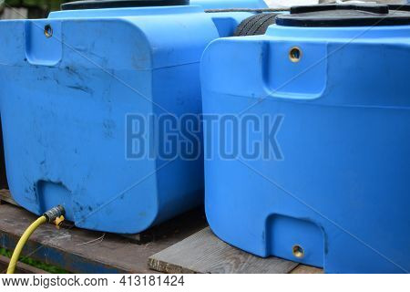 Blue Plastic Barrels Contain.plastic Barrels. Warehouse Of Chemical Products. Stelazhy With Barrels.