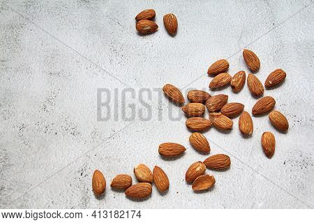 Almonds With Peeled, Fresh Almonds Scattered, Vitamins And Trace Elements, A Large Amount Of Spilled