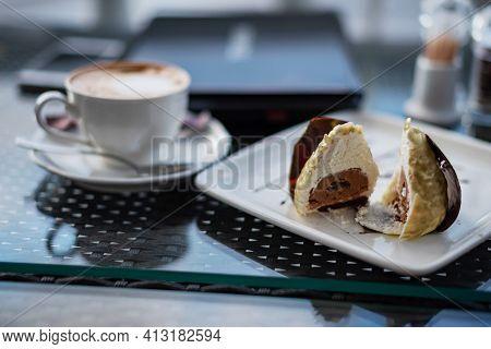Unusual Dessert Close-up, Beautiful Servinga White Square Plate With An Unusual Truffle Cake, A Beau