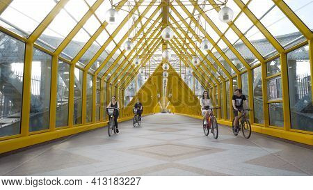 Moscow, Russia - July, 2020: Pedestrian Bridge With Cyclists. Action. Beautiful Yellow Bridge For Pe