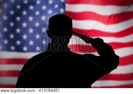 Us Military Soldier Saluting Flag. National Hero And Veteran