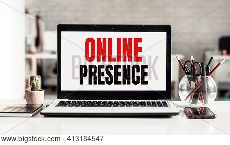 Laptop With Online Presence Text On Modern Office Background.