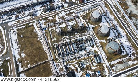 Aerial View Of The Vast Territory Of A Large Industrial Asphalt Plant With High Pipes. Environmental
