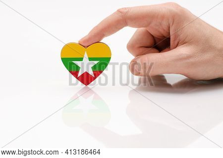 Myanmar Flag. Love And Respect Myanmar. A Man's Hand Holds A Heart In The Shape Of The Myanmar Flag