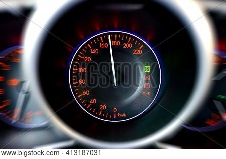 The Speedometer Shows A Dangerously High Speed. Dashboard With Motion Blur Effect Of Car Going Fast.