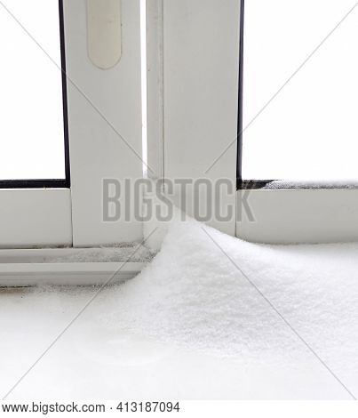 Snowdrifts After The Heavy Snow Storm. Snow Drifts At Home During A Blizzard On A Winter Day