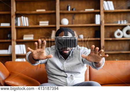Attractive Black Man Enjoying Virtual Reality Headset In Modern Design Apartment, Home Play Concept,
