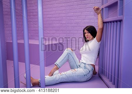 A beautiful asian model is jailed in a lavender cell waiting to plead her case