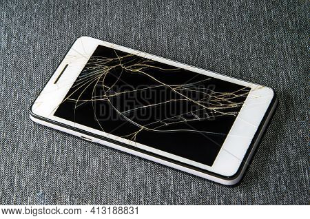 Crack On The Glass. Broken Screen. Broken Phone. Cracked Glass Background.