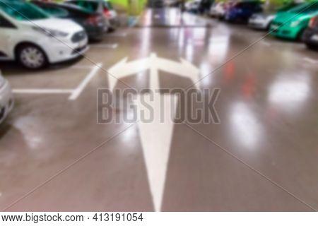 Rent Parking Space Blurred. Car Lot Parking Space In Underground City Garage. Empty Road Asphalt Bac