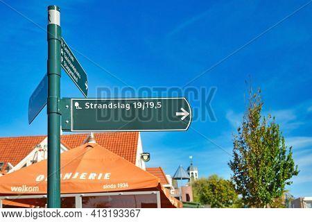 De Koog, Texel, Netherlands - August 2019: Road Sign Leading To Holiday Park Called 'strandslag' In