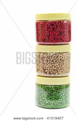 Red, Green And White Pepper Peas Casting Up In Boxes Isolated On White Background