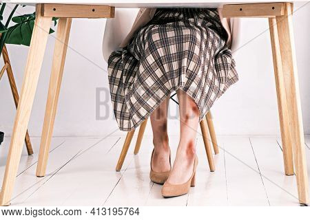 Battery, Physical Abuse And Domestic Violence. View Under The Table On Female Legs Covered With Brui