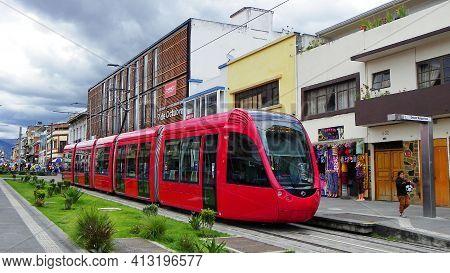 Cuenca, Ecuador - June 10, 2020: Red City Tramway (tram) Crosses Plaza Civica In Historical Center O