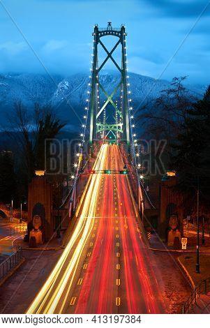 Lions Gate Bridge Evening Rush Hour. The Lions Gate Bridge At Twilight. Stanley Park. Vancouver, Bri