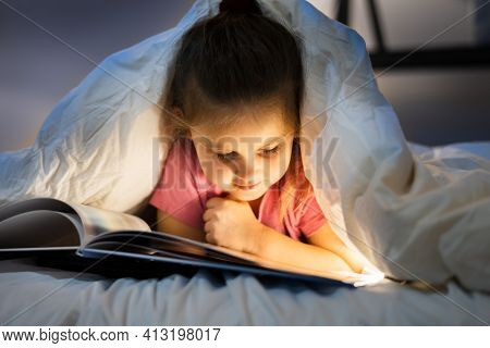 Little Child Reading Book With Fairy Tale Story