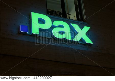 Lugano, Ticino, Switzerland - 14th January 2021 : Luminous Pax Assurance Sign Hanging On A Building