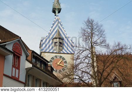 Close Up View Of The Zytturm Clock Tower Building In The Historical City Center Of Zug In Switzerlan