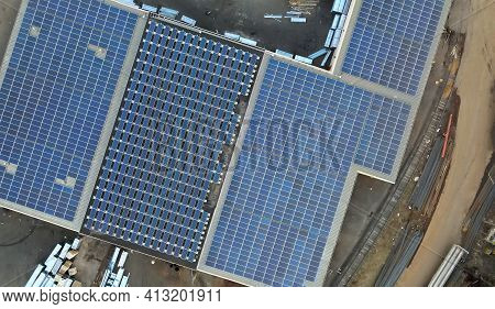 Solar Panels System In The Commercial Building A Warehouse On Roof Of Urban Clean Ecological Energy
