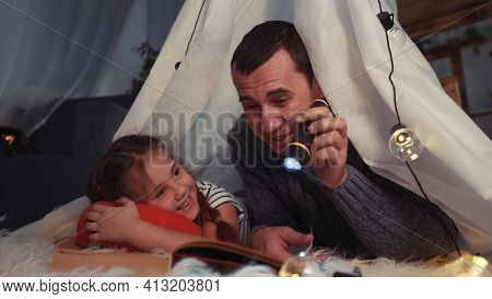 Happy Family At Home Dream. Dad And Daughter Happy Family At Home Reading A Book In The Evening In S