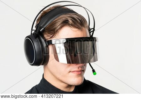 Man with smart glasses and headphones futuristic technology