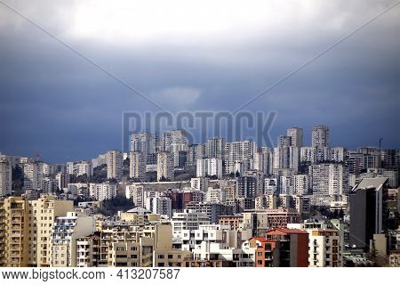 Tbilisi Cityscape View From The Moutain. A Cityscape With Dramatic Clouds  In The Sky.