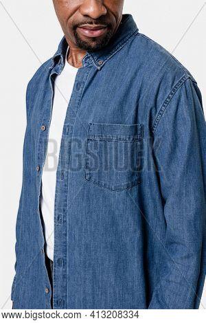 African American man wearing denim long-sleeve shirt