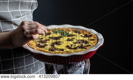 Women's Hands Holding Hot Homemade Quiche Pie With Mushrooms And Cheese, Traditional French Pie Quic