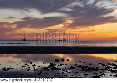 Sunset Patterns As Clouds And Sun Backlight And Brighten Tidal Mulberry Grove Beach On Great Barrier