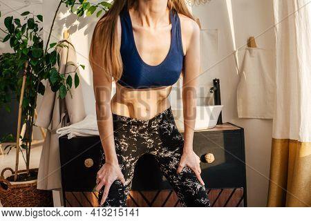 Portrait Of Unrecognizable Woman Doing Abdominal Vacuum.