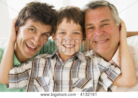 Grandfather With Son And Grandson Smiling.