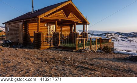 Wooden House - Bath. Made From Natural Logs. There Is A Chimney On The Roof. On The Terrace, In The