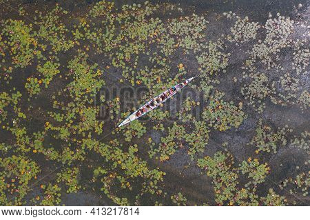 Aerial Top View Of A Tourist Boat Pink Lotus Flowers In Pond Or Lake In National Park In Thale Noi,