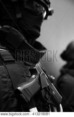 Close Up Soldier Keeping Modern Gun While Wearing Bulletproof Vest. Uniform Concept.