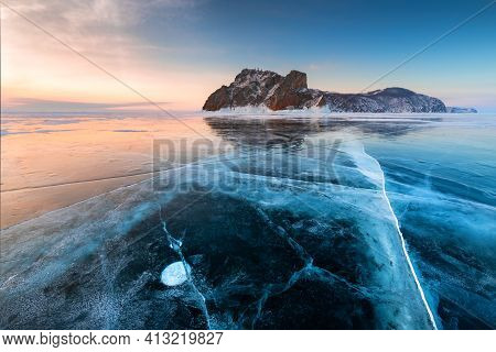 Baikal Lake In Winter With Transparent Cracked Blue Ice. Cape Khoboy Of Olkhon Island, Baikal, Siber