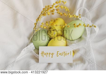 Painted Easter Yellow And Green Chicken And Quail Eggs, Spring Mimosa Sprig, Greeting White Card Wit