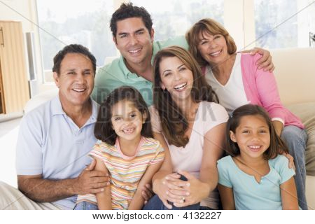 Three generation Families sat on a sofa together poster
