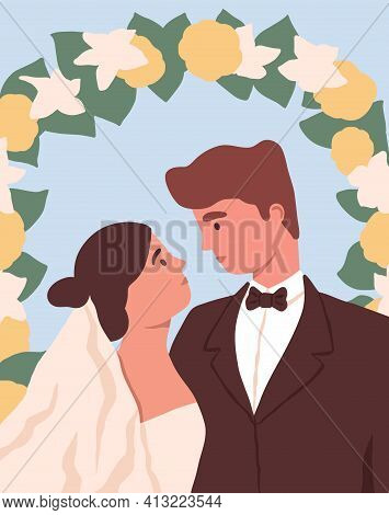 Portrait Of Newly-married Love Couple At Wedding Flower Arch. Marriage Of Man And Woman. Bride In Br