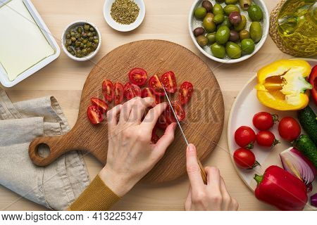 Vegetarian Vegan Food. Chopping Tomatoes, Cutting Vegetables For Greek Salad Horiatiki. Woman Hands