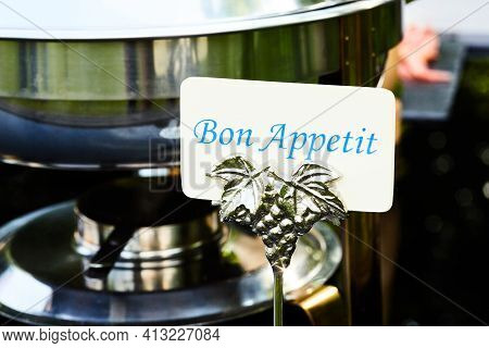 Sign With The Text Bon Appetit On The Table