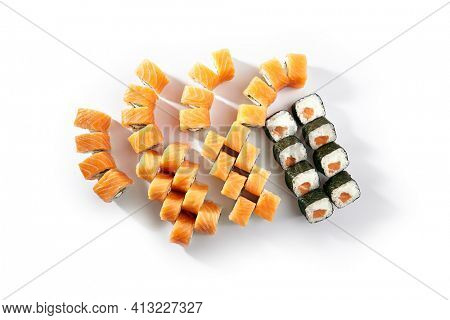 Sushi Rolls Set with Various Salmon Maki Rolls. Maki sushi rolls on white background top view