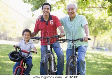 Grandfather Son And Grandson Bike Riding.