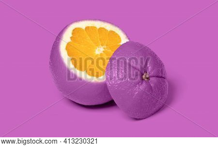 Weird Purple Sliced Orange Isolated On A Pink Background
