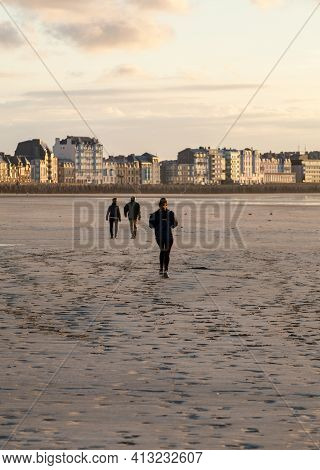 Saint-malo, France - September 14, 2018:  Woman Is Running  Along The Beach In Saint-malo, Brittany,
