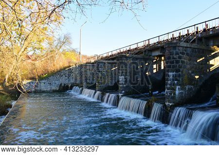 River Dam. Dam Water Release, The Excess Capacity Of The Dam Until Spring-way Overflows. Streams Of