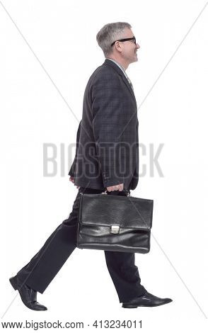 confident man with briefcase striding forward. isolated on a white