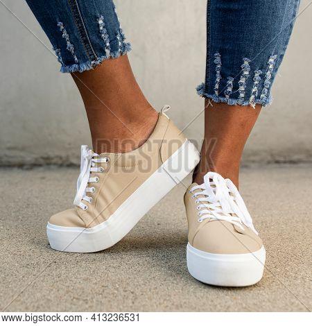 Khaki canvas sneakers women's shoes apparel shoot