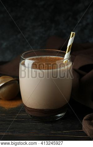 Glass Of Chocolate Milkshake, Kitchen Towel And Sieve On Wooden Table